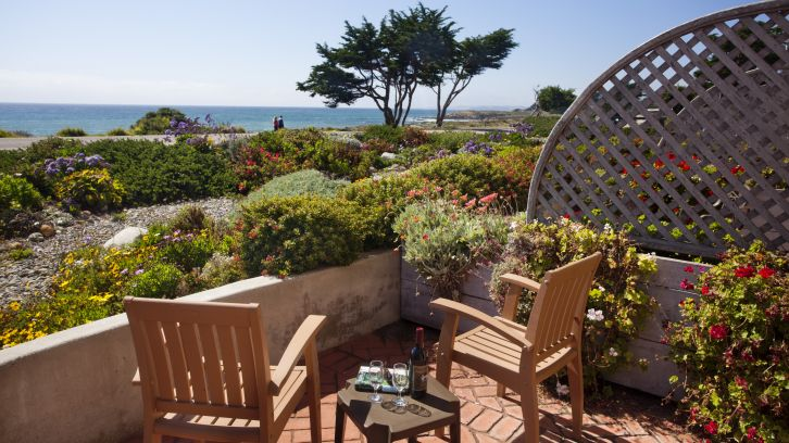 Patio with ocean view at Pelican Inn & Suites