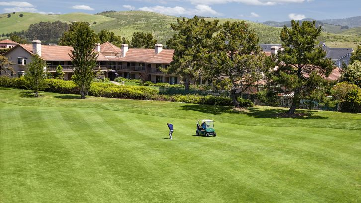Exterior View of Half Moon Bay Lodge, man playing golf