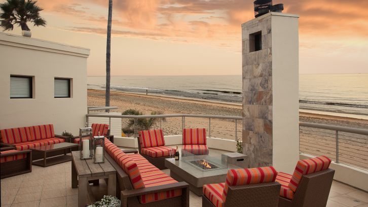Beach Patio Seating at Sandcastle Inn