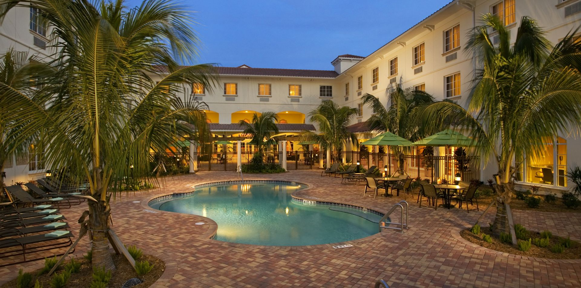 Exterior View of Hilton Garden Inn Port St. Lucie and swimming pool