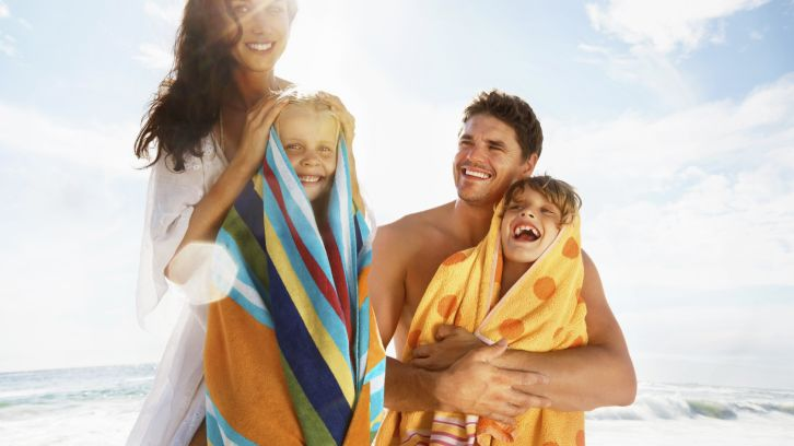young couple toweling off their children