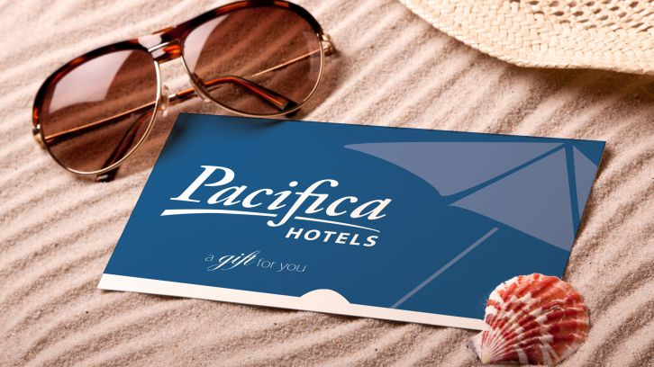 sunglasses, Pacifica HOtel gift card, seashell, sunhat on sand