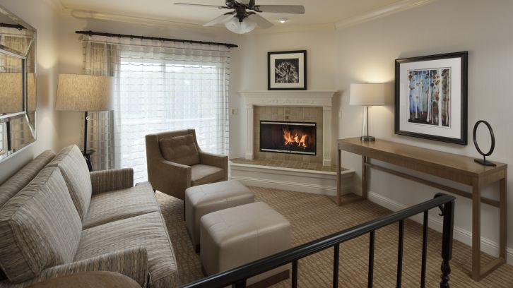Suite living room with fireplace at Pelican Inn & Suites