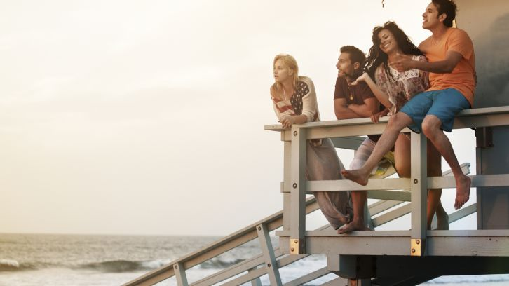 friends hanging out on lifeguard tower
