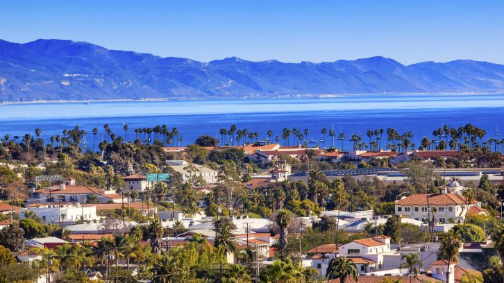 wide overhead view of Santa Barbara neighborhood, ocean, mountains