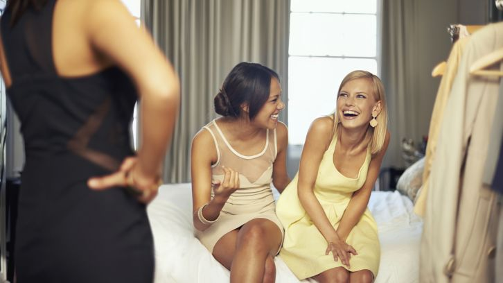 women in hotel room laughing
