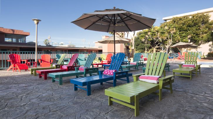 colorful deck chairs near pool and spa