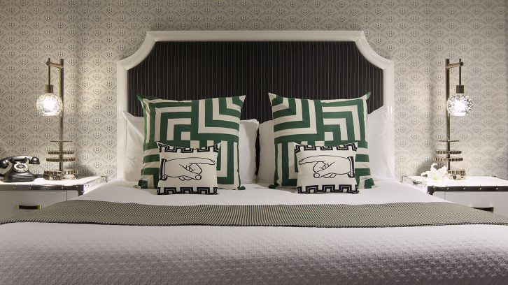 king bed with designer pillow cases and bedside lamps