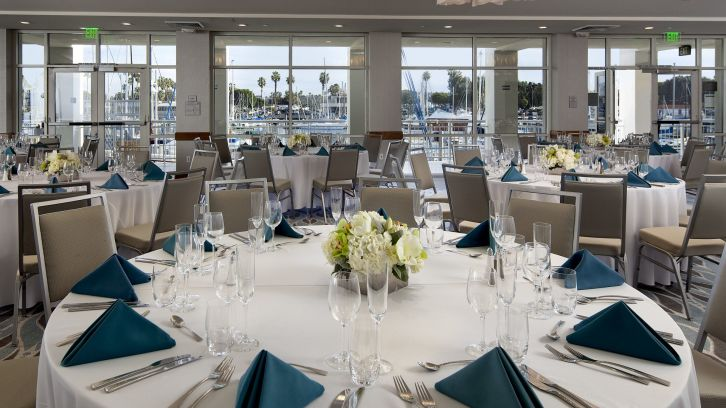 oceanview reception area with tables set for dinner