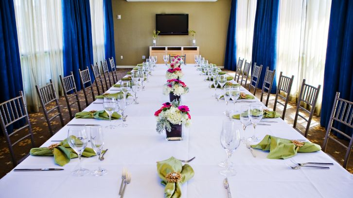 long table with colorful table settings