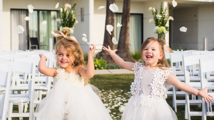 flower girls walking down isle
