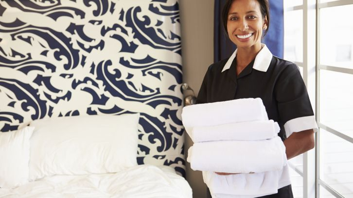 hotel maid holding fresh towels