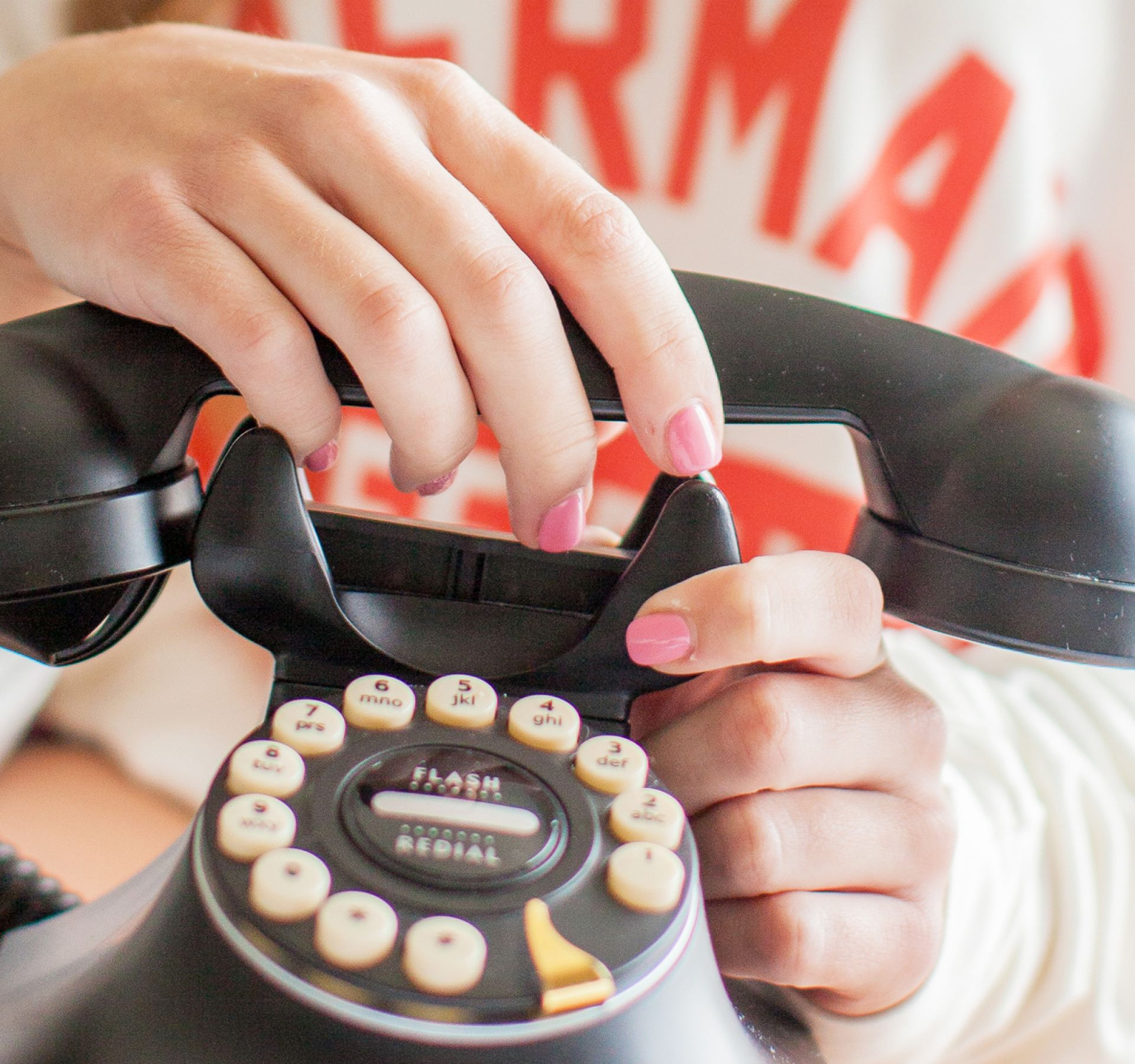 girl holding rotary phone