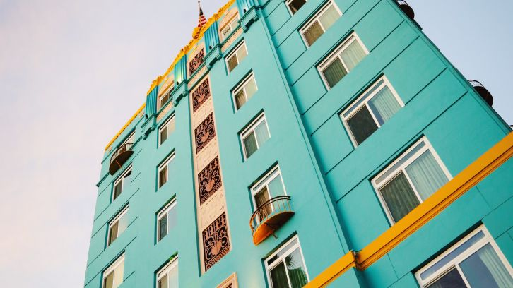 exterior ground view of hotel with turquois colored walls