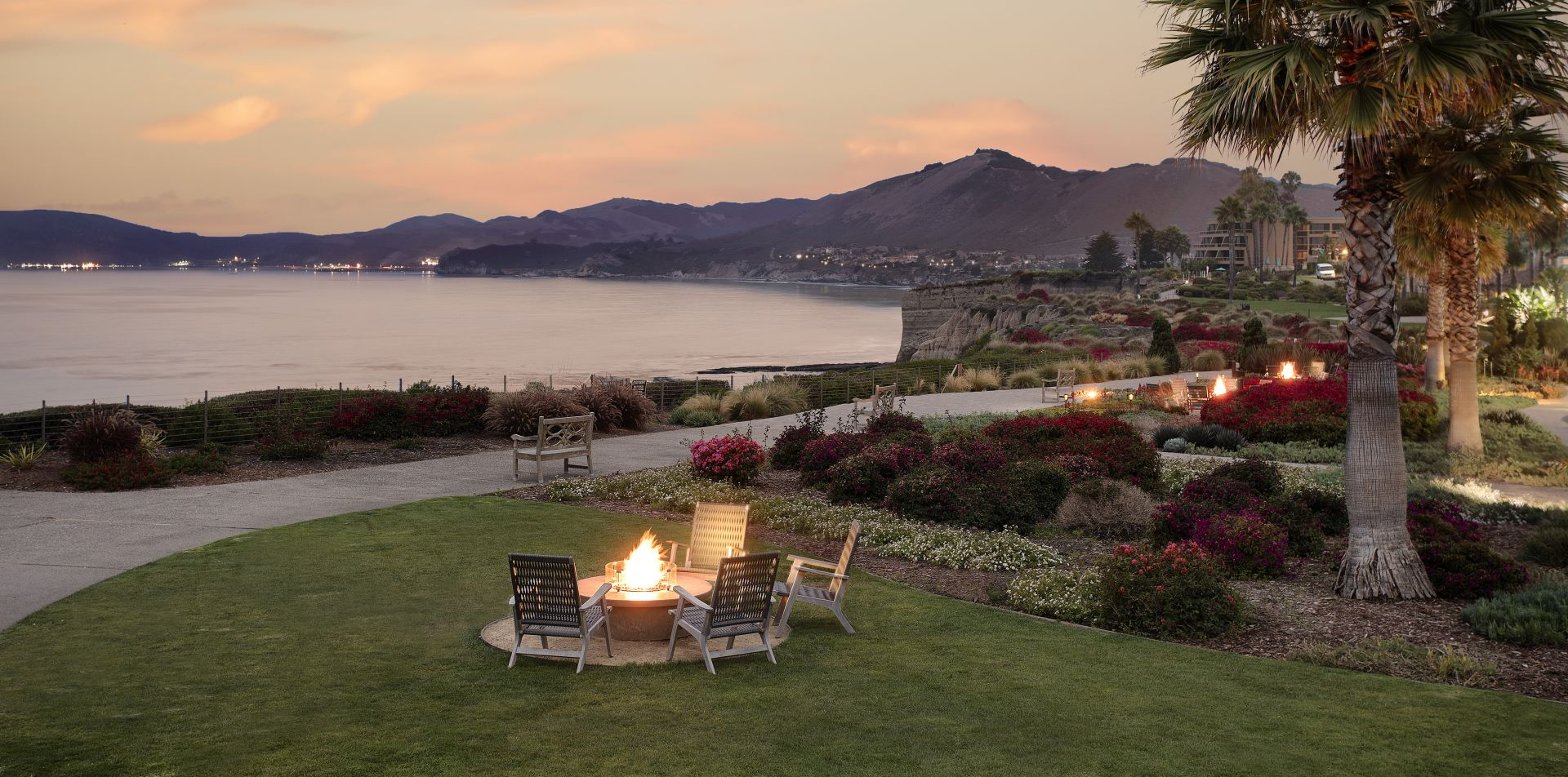 Lawn with firepit overlooking ocean and mountains