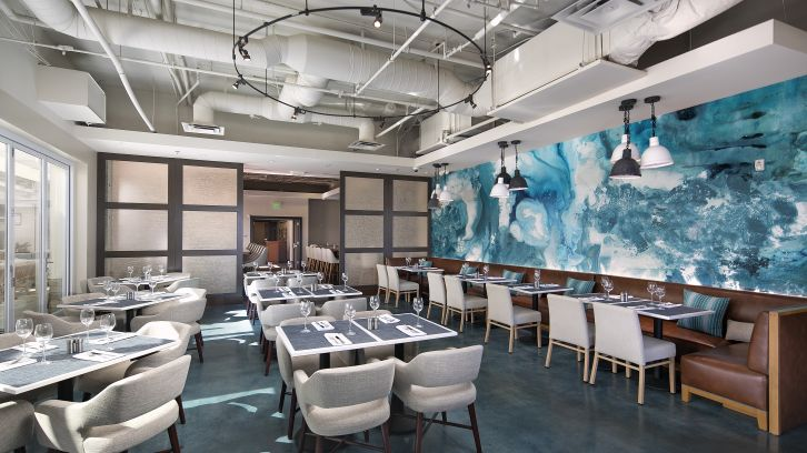 dining area with blue wall mural